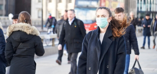 What is the efficacy of standard face masks compared to respirator masks in preventing COVID-type respiratory illnesses in primary care staff?