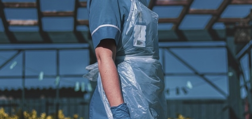 What is the effectiveness of protective gowns and aprons against COVID-19 in primary care settings?
